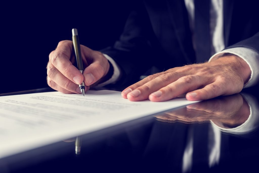 Businessman signing a document