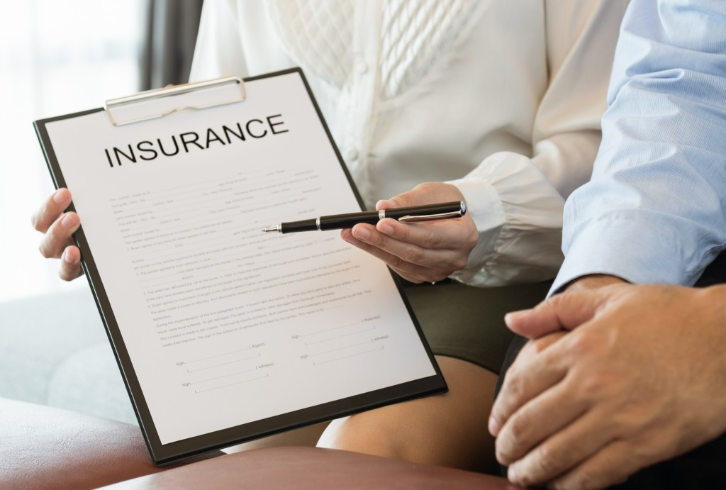 insurance agent showing a copy of policy
