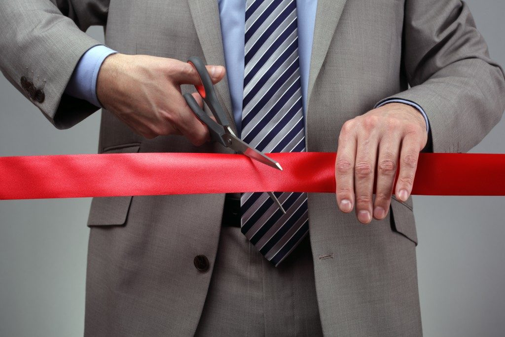 Cutting a red ribbon for a launch