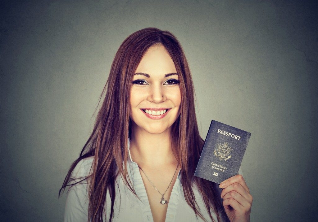 immigrant woman holding a passport