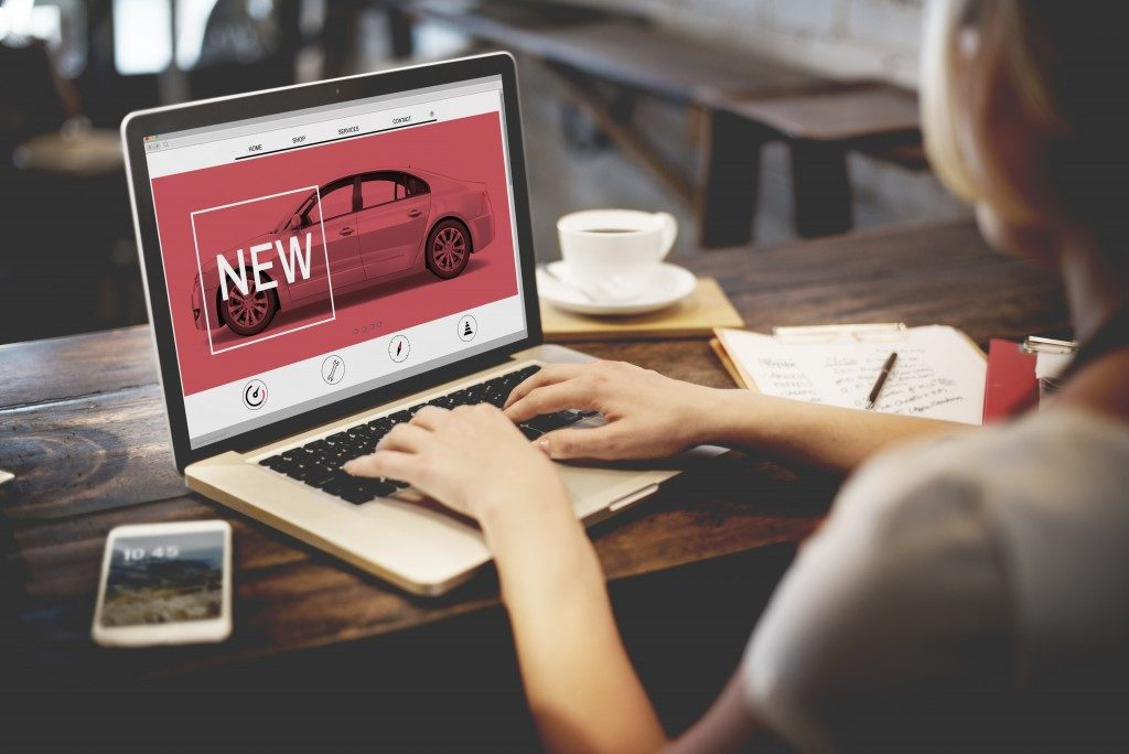 Woman looking at a new car online