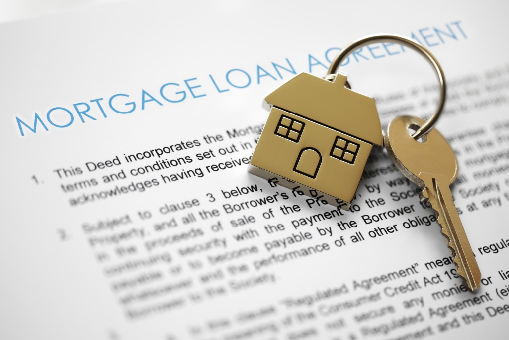 Mortgage loan agreement application with house shaped keyring