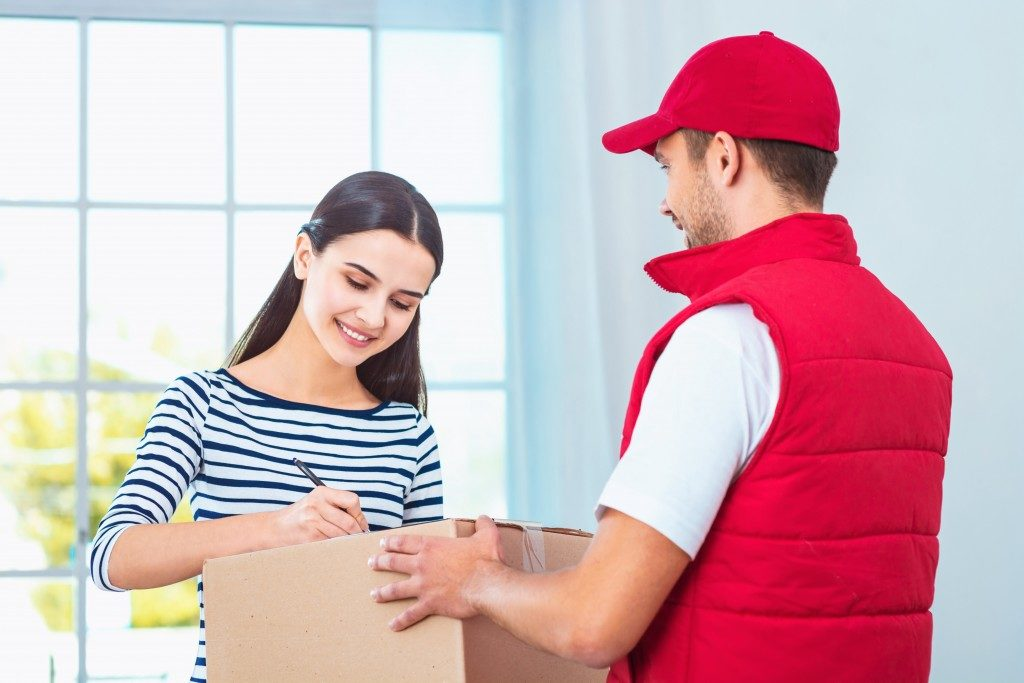 a man delivering an item to a client