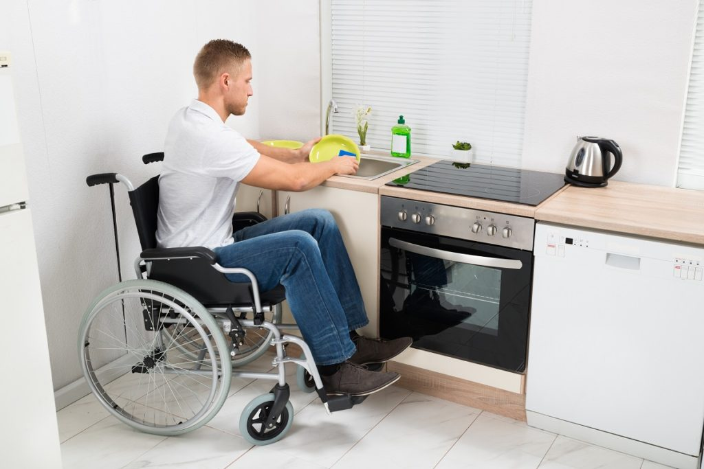 Person with disability doing the dishes