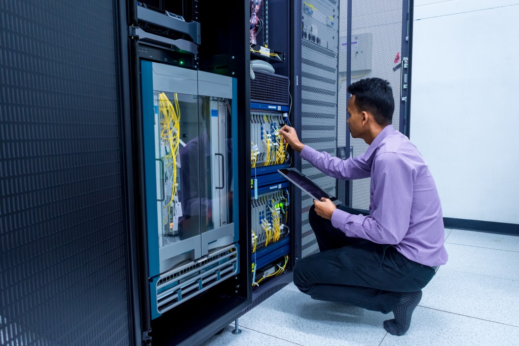 man checking the server data