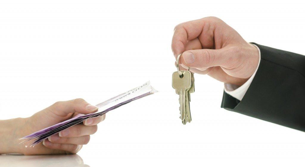 Handing keys and money
