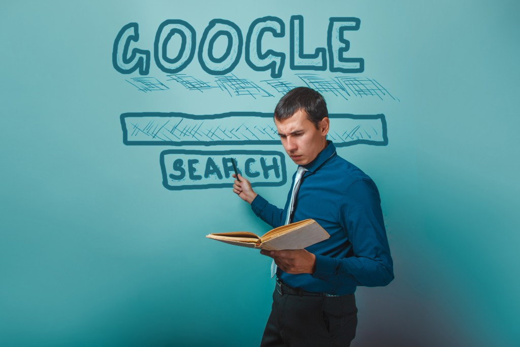 man shows a pointer to search Google