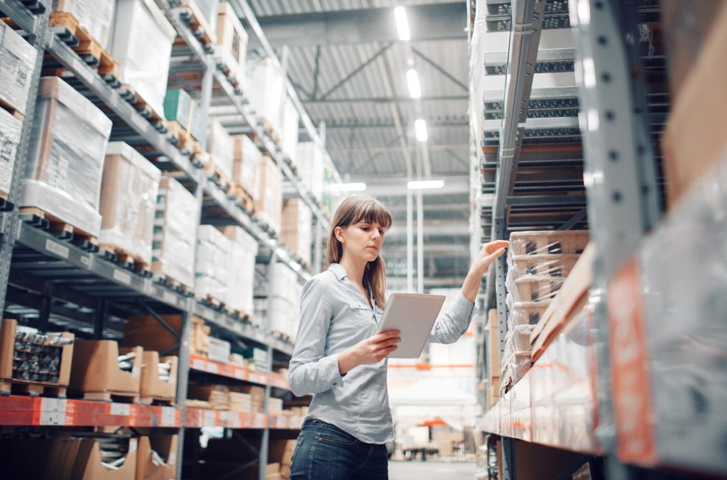 woman checking warehouse inventory